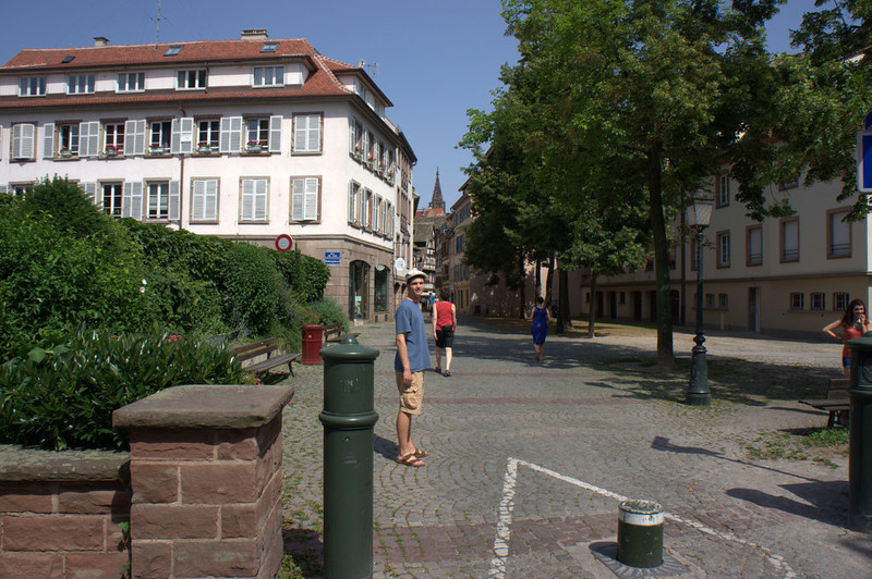 Elisha now at the edge of Le Petit France; you can see the cathedral's tower in the background.