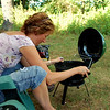 Lisa putting together the Walmart Grill, We were discussing how cute this little grill was and only $5 dollar more than she paid for hers which had no cover lol!!  Lisa and this little grill became close friends as she did all the cooking : )