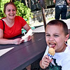 Getting in some last licks of Summer is Audrey Riedle of Pepperell with her son Brady Hebert 5, the two were st Johnson's Restaurant and Dairy Bar on Rt119 in Groton. SUN/ David H.Brow