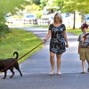 Taking in an early eveing walk with the family dog CoCa, on the Rail Trail in Groton is Monica Maciel, and her son Weston Maciel 8, they are from Groton. SUN/ David H.Brow