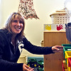 Setting up her pre-school classroom at the Groton Community School in their new location is teacher Naomi Lynch of Townsend. SUN/ David H.Brow