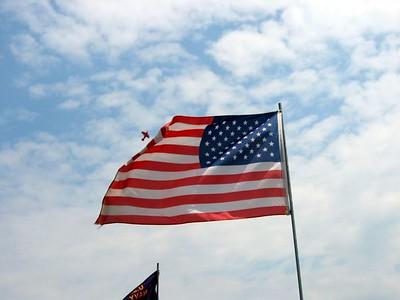 Biplane and flag