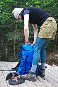 Sarah packing AMC campsite