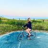 Samantha Zouzas Malone enjoys a bike ride overlooking Tom Nevers Beach.
