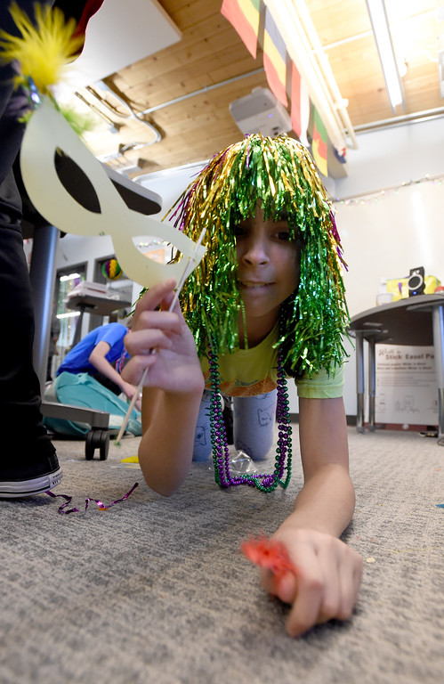 ". Olaya Garcia-Grau picks up scrap paper from their Mardi Gras art project. Beginning French students at Summit Middle School celebrated ""Fat Tuesday\"" of Mardi Gras today. Summit Middle School has submitted its formal application to open a charter high school.  For more photos, go to dailycamera.com. Cliff Grassmick  Photographer  February 13, 2018"