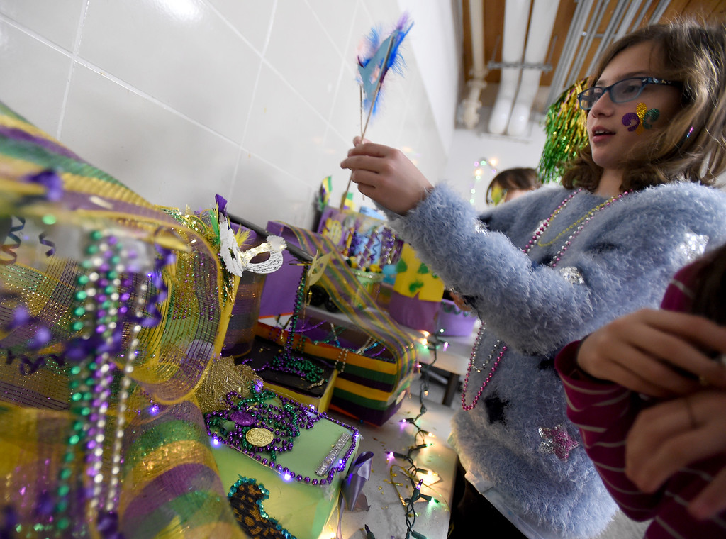 ". Celia Guitonde adds a feather mask to her Mardi Gras float. Beginning French students at Summit Middle School celebrated ""Fat Tuesday\"" of Mardi Gras today. Summit Middle School has submitted its formal application to open a charter high school.  For more photos, go to dailycamera.com. Cliff Grassmick  Photographer  February 13, 2018"