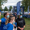 Girls from University of New England pose for a photo with Patrick Dempsey at the finish line during Saturday's Dempsey Challenge. Photo by Russ Dillingham/Sun Journal