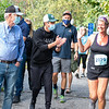 Patrick Dempsey, second from left, cheers on a runner during Saturday's Dempsey Challenge along the Riverwalk in Auburn. Photo by Russ Dillingham/Sun Journal