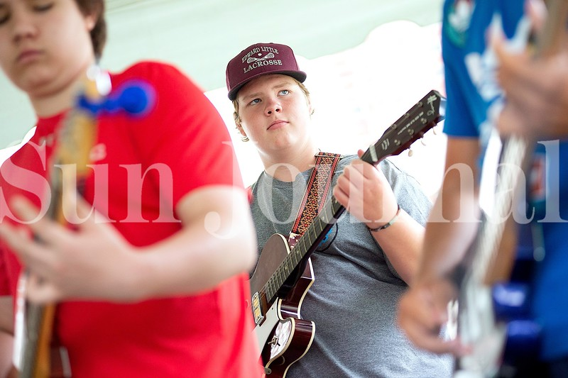 Bjorn Sanberg, 14, of Auburn plays the guitar Monday during Camp of Rock in Auburn.