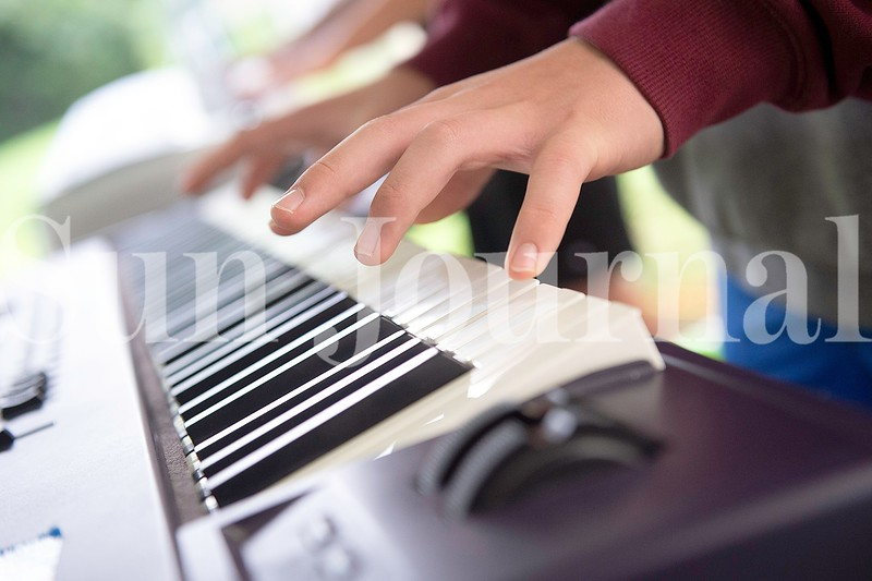 Kai Thistle, 14, of Auburn plays the keyboards Monday during Camp of Rock in Auburn.