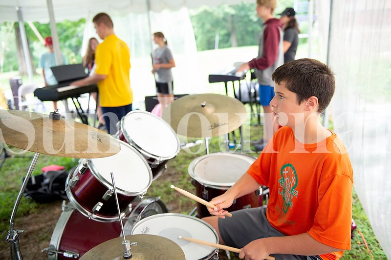 Grady Miller, 12, of Norway plays the drums Monday during Camp of Rock in Auburn.