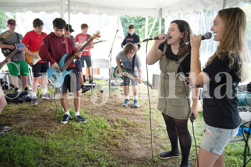 Maddie Adams, right, of Otisfield and Annabeth Treadwell of Auburn sing during Camp of Rock at the Great Falls Performing Arts Center in Auburn.