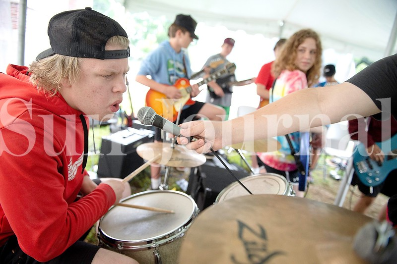 Drummer AJ Milliken, 16, of Mechanic Falls throws out some lyrics during the playing of the Van Halen tune Panama during Camp of Rock Monday in Auburn.