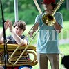 Connor Davis, left, and Ian Lathrop learn the Queen song Another One Bites the Dust Monday during Camp of Rock in Auburn.