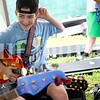 Hunter Richards, 14, of Durham gets ready for the next song Monday during Camp of Rock in Auburn.