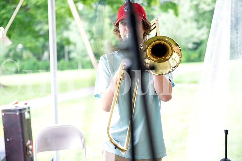 Ian Lathrop, 17, of Auburn plays the trombone during Camp of Rock Monday in Auburn.