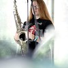 Kahdiana Knight, 14, of Auburn is a saxaphone player for Inattentive, the band of 24 teenagers that will perform Friday at Lost Valley in Auburn.