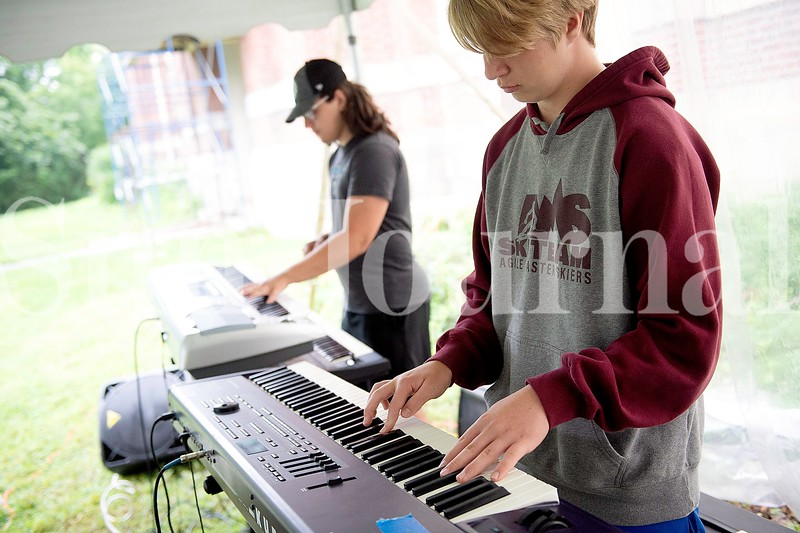 Jameson Treadwell, left, and Kai Thistle, both of Auburn, play the keyboards Monday during Camp of Rock in Auburn.