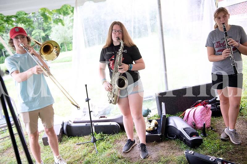 Ian Lathrop, left, of Auburn, Kahdiana Knight, center, of Auburn and Clara Wilson of Sabattus perform Monday during Camp of Rock in Auburn.
