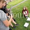Evie McGuigan, 12, of Auburn turns music pages for Clara Wilson, left, and Kahdiana Knight Monday during a Camp of Rock break in Auburn. Wilson and Knight continued to play during their break.