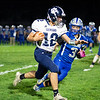Cutis Errington of Dirigo High School scoots down the sideline on his way to a first half touchdown run during Friday's game against Mountain Valley High School. Kaden Paaso of Mountain Valley tries to stop Errington.