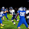 Dirigo High School quarterback Charlie Houghton gains yards over the middle during Friday's game against Mountain Valley High School in Rumford.