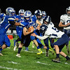 Lucas Libby of Mountain Valley High School gains yards over the middle during Friday's game against Dirigo High School in Rumford.