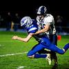 Gavin Micks of Dirigo High School drags down Airick Richard of Mountain Valley High school during the first half Friday in Rumford.