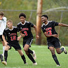Sam Labumba, right, of Lisbon High School celebrates his second half goal that tied the game against Hall-Dale High School in Lisbon on Tuesday.