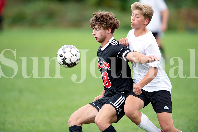 Hunter Brissette of Lisbon High School controls the ball during Tuesday's game against Hall-Dale High School.