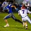FAIRFIELD, ME - OCTOBER 22:  Lawrence running back Parker Higgins, left tries to outrun Messalonskee defensive back Brady Doucette during a football game Friday October 22, 2021 on Keyes Field at Lawrence High School in Fairfield. (Staff photo by Joe Phelan/Staff Photographer)