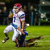 FAIRFIELD, ME - OCTOBER 22:  Messalonskee quarterback Brady Doucette, 7, left, gets tackled by Lawrence Lawrence defensive back Parker Higgins during a football game Friday October 22, 2021 on Keyes Field at Lawrence High School in Fairfield. (Staff photo by Joe Phelan/Staff Photographer)