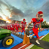 OAKLAND, ME - SEPTEMBER 10: Haven Birch, right, and the rest of the Messalonskee team touches the carved wooden eagle as they go onto field before a football game against Edward Little Friday September 10, 2021 in Oakland. (Staff photo by Joe Phelan/Staff Photographer)