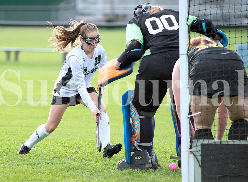 Leonie Quimby of Leavitt Area High School shoots the ball through the legs of Maranacook goalkeeper Alyssa Pratt during the first half of Thursday's matchup in Turner. Quimby scored on the play to put the Hornets up 3-0.