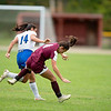 Julia Wells, left, of Mt. Abram and Lydia Rice of Monmouth/Winthrop collide during Wednesday's game in Monmouth.