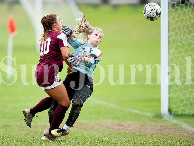 Mt. Abram goalkeeper Haley Bate and Brooklyn Federico of Monmouth/Winthrop collide late in the second half in Monmouth Wedneesday. The ball went wide of the net.