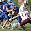 Alex Hinkley (78) of Oak Hill High School tries to find room for Maverick Swan (9) during Saturday's game against Foxcroft Academy in Wales. Daryn Slover/Sun Journal