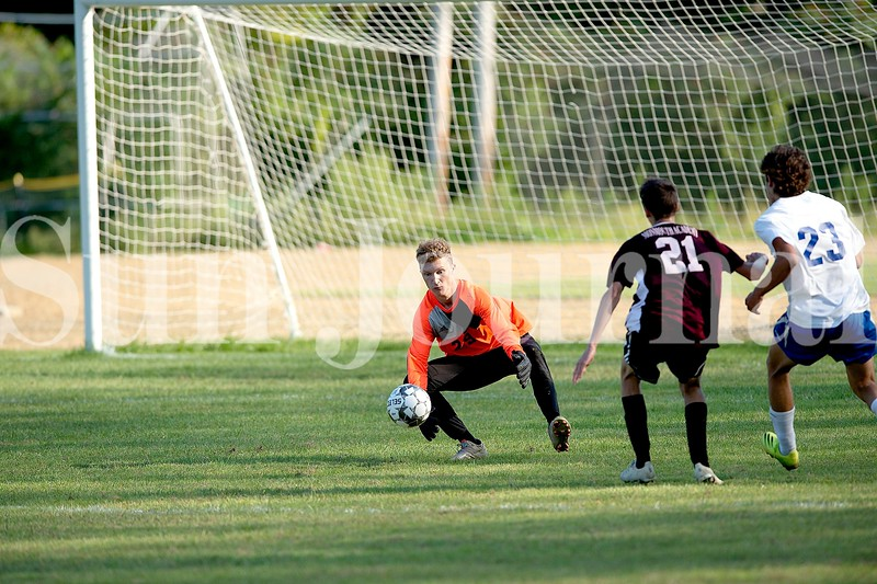 Monmouth Academy goalkeeper Hunter Frost comes out of net to make a save during Wednesday's game against Oak Hill High School. Daryn Slover/Sun Journal