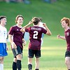 Brandon Smith (2) of Monmouth Academy celebrates Wednesday with his teammates Hayden Fletcher and Ben Hamann (3) after Smith scored during the second half against Oak Hill High School in Monmouth. Smith's goal put the Mustangs up 6-2. Daryn Slover/Sun Journal