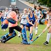 Oak Hill High School goalkeeper Sierra Lane blocks a shot by Grace Averill of Dirigo High School Monday in Dixfield.