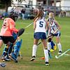 Grace Robbins, right, of Dirigo High School fires a shot at Oak Hill High School goalkeeper Sierra Lane Monday in Dixfield. Lane made the save.