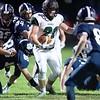 Reece Davis of Spruce Mountain High School breaks through the Dirigo defensive line during the first period in Dixfield Friday. Daryn Slover/Sun Journal