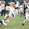 Keegan Turner of Spruce Mountain High School is tripped up on his way to a first period touchdown during Friday's game against Dirigo High School in Dixfield. Daryn Slover/Sun Journal