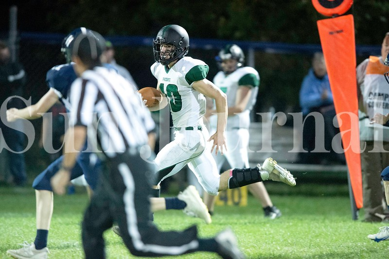Spruce Mountain quarterback Cambden Phillips runs the ball up the sideline for a big gain against Dirigo High School on Friday. Daryn Slover/Sun Journal
