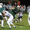 Jace Negley (53) of Leavitt Area High School pressures Fryeburg Academy quarterback Gunnar Saunders Friday in Turner.
