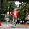 Jessica Day of Scarborough and her 6-year-old daughter, Natalie, cross the finish line Sunday during the Triple Crown 5K in Auburn. The event was Jessica Day's first 5K. Photo by Daryn Slover/Sun Journal