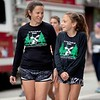 Andrea Vincent of Auburn walks to the Triple Crown 5K start line Sunday with her 10-year-old daughter, Emelia, in Auburn. Photo by Daryn Slover/Sun Journal