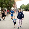 Emilia Fotter, 2, of Auburn finishes the Auburn Firefighters Kid's Fun Run with her grandmother, Mona Murphy of Auburn, Sunday in Auburn. The fun run for children was held prior to the start of the Triple Crown 5K. Photo by Daryn Slover/Sun Journal