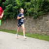 Ted Britt and his daughter, Abigail, sprint to the finish Sunday during the Triple Crown 5K in Auburn. Photo by Daryn Slover/Sun Journal