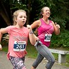 Sheree Jackson, right, of Lewiston and her daughter, Adley, sprint to the finish Sunday during the Triple Crown 5K in Lewiston. Photo by Daryn Slover/Sun Journal